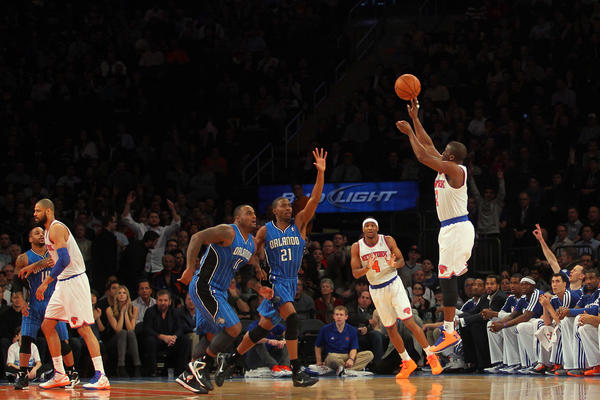 New York Knicks guard Raymond Felton (2) shoots a three-point shot against the Orlando Magic during the first quarter of an NBA game at Madison Square Garden.