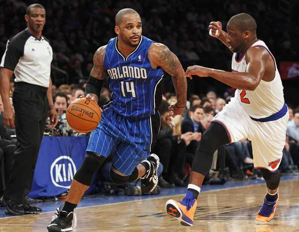 Orlando Magic point guard Jameer Nelson drives to the basket defended by New York Knicks point guard Raymond Felton in the second quarter of their NBA basketball game at Madison Square Garden in New York