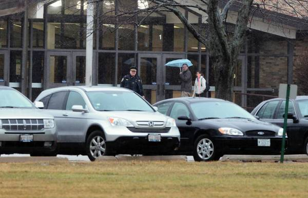 Cary police officers patrol Cary-Grove High School on Wednesday following a code red drill, which included simulated gunfire in the hallways.