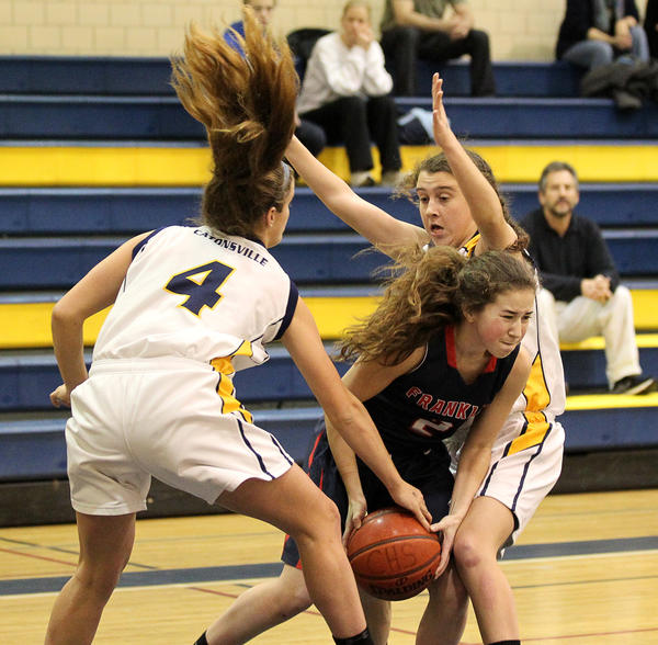Pressure trapping defense like this from Catonsville's Andrea McTaggert, right, and Deb Milani on Franklin's Aly Axman helped the Comets to a 51-23 victory Wednesday night.