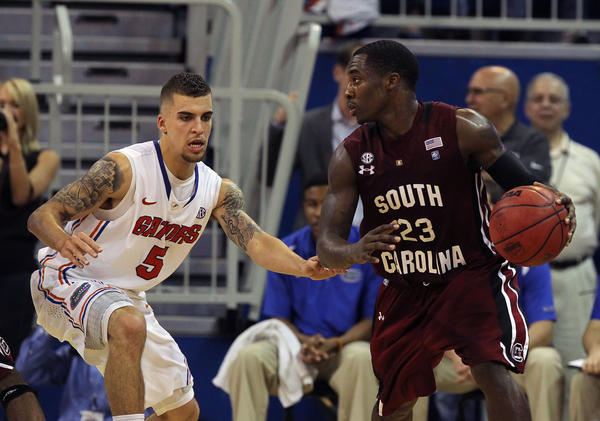 South Carolina Gamecocks guard Bruce Ellington (23) drives to the basket as Florida Gators guard Scottie Wilbekin (5) defends during the first half at the Stephen C. O'Connell Center.
