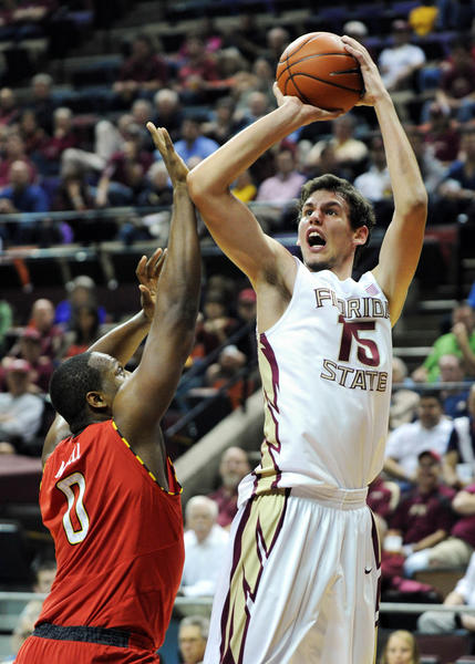 Florida State Seminoles center Boris Bojanovsky (15) shoots the ball over Maryland Terrapins forward Charles Mitchell (0) during the first half of the game at the Donald L. Tucker Center.