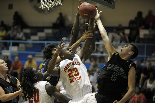 Deerfield Beach's Terence Johnson rebounds the ball in front of Cypress Bay's Alex Jurko during the first half of their Big 8 Boys Basketball Championship quarterfinal game.