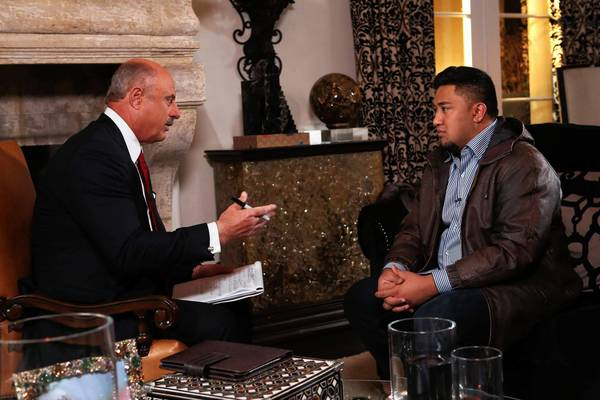TV talk show host Dr. Phil McGraw, left, interviews Ronaiah Tuiasosopo, the Antelope Valley man who says he impersonated a woman to get close to Notre Dame star Manti Te'o.