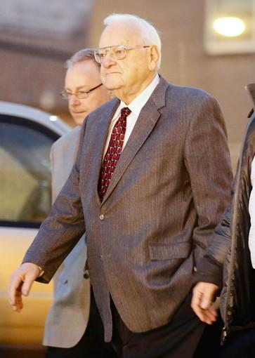 Former Gov. George Ryan is escorted to a halfway house in Chicago on Wednesday.