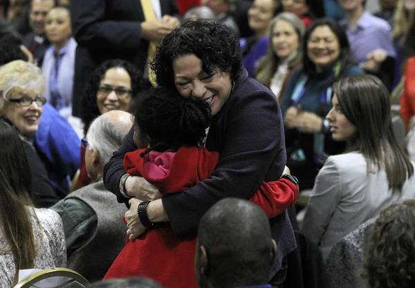 "Supreme Court Justice Sonia Sotomayor embraces a young girl while speaking at the Harold Washington Library in Chicago for a discussion of her memoir, ""My Beloved World,"" on Wednesday."