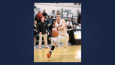 Jake Close drives toward the hoop scoring two of his 15 points for the Somerset Eagles on Wednesday.