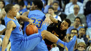 USC put a roadblock in UCLA's Pac-12 Conference title hopes by upsetting the Bruins, 75-71, in overtime, on Wednesday night at Pauley Pavilion.