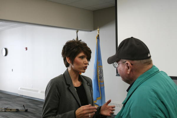 U.S. Representative Kristi Noem talks to Gaylen Larson of Frederick at a town hall meeting in Aberdeen on Wednesday. American News photo by Jeff Natalie-Lees