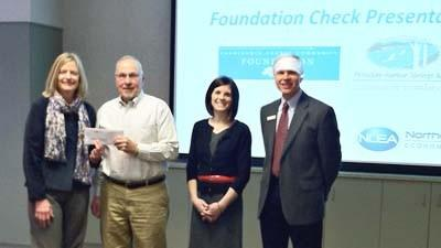 Local community foundations¿ representatives present grant checks to assist Northern Lakes Economic Alliance in establishing its new Service Provider Program. On hand for the presentation are (from left) Charlevoix County Community Foundation program officer Maureen Radke, Northern Lakes Economic Alliance board chairman Sheridan Rhoads, Petoskey-Harbor Springs Area Community Foundation program officer Sara Ward and Northern Lakes entrepreneurship director Tom Erhart.