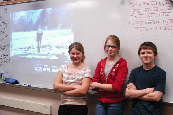 "Boyne City eighth-graders (from left) Camella Zipp, Evie Berge and Simon Shankleton show parents and the public stop-motion videos they have made using their iPads on American Revolutionary War battles for history class. ""It was fun,"" said Evie, of making a video presentation on the Battle of Bunker Hill."