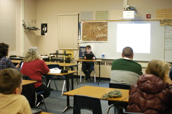Josh Robinson, a fourth grade student at Boyne City Elementary School teaches members of the community how to navigate Google Maps on an iPad during the school district's technology night Wednesday.