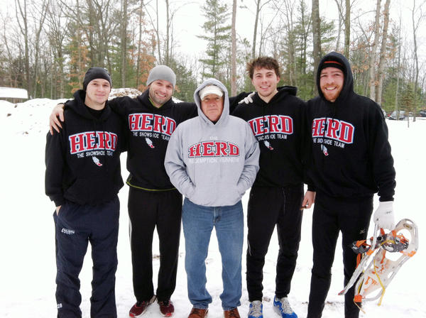 The Herd snowshoe team is comprised of (from left) Blaise Henning, Jacques Henning, coach Keith Henning, Derek Henning and David Ernsberger. All four racers placed within the top six in the teams first race at the Bigfoot Snowshoe 5K and 10K in Traverse City at the Timber Ridge Campground.