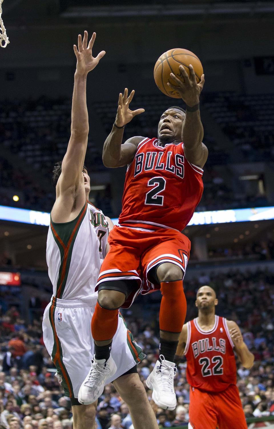 Bulls guard Nate Robinson drives for a shot as Milwaukee Bucks forward Ersan Ilyasova defends during the second quarter Wednesday at the BMO Harris Bradley Center.