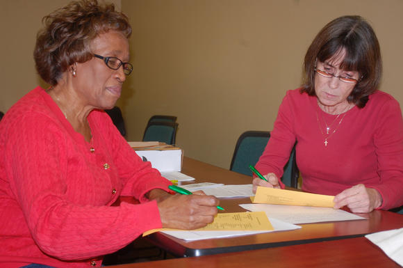 Volunteers Betty Jean Burton, left, and Cindy Conover review two surveys Blue Grass Community Action Partnership received Wednesday in the 2013 K-Count of homeless people.