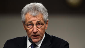 Hagel defends record, spars with critics in Senate hearing
