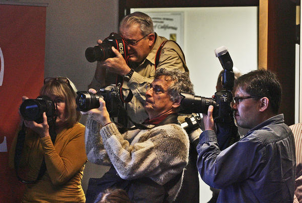 Several photographers and several television news photographers cover the news at Caltech where an earthquake early warning press conference was hosted on Monday, January 28, 2013. The California Integrated Seismic Network is a collaboration between Caltech, UC Berkeley and the USGS where researchers are using real-time data to create and test early warnings to computers and people carrying cell phones with an app about an earthquake occurrence.