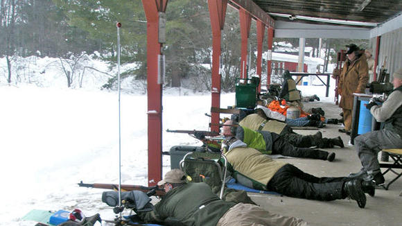 Shooters work at sighting in their profiles prior to the start of a recent competition at the Northland Sportsmen's Club.