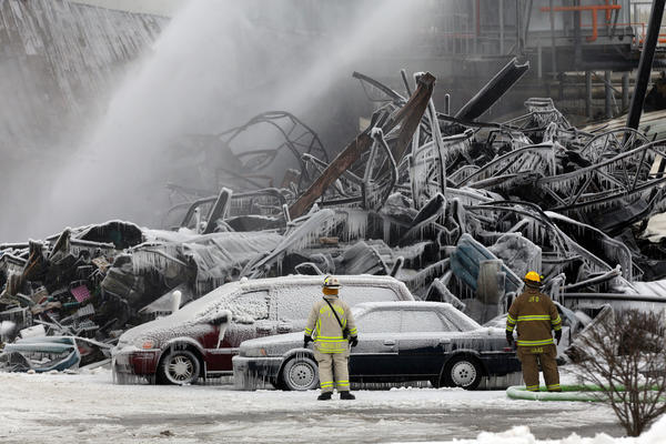 Firefighters continue to work to extinguish a fire at the Echo Lake Farms Produce Company in Burlington, Wisc. More than 300 firefighters and paramedics from 80 departments responded to the blaze.