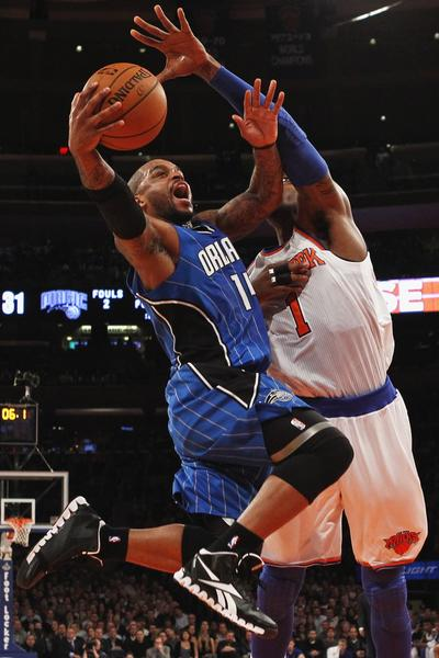 Orlando Magic point guard Jameer Nelson drives to the basket past New York Knicks forward Amar'e Stoudemire in the first quarter of their NBA basketball game at Madison Square Garden in New York, January 30, 2013.