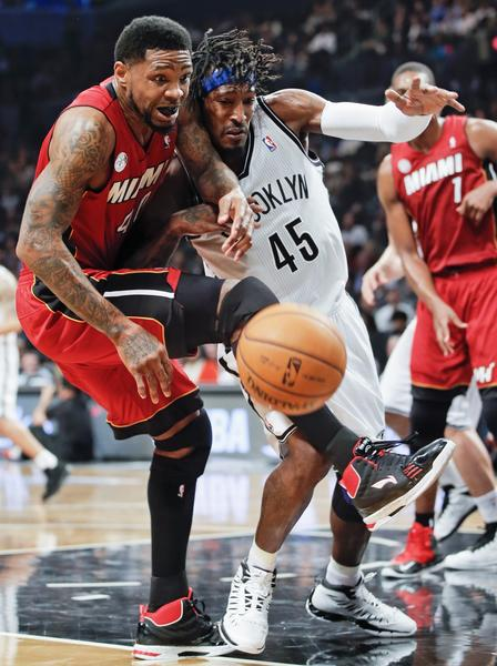 Miami Heat forward Udonis Haslem (R) and Brooklyn Nets forward Gerald Wallace battle for a loose ball in the third quarter of their NBA basketball game in New York, January 30, 2013.
