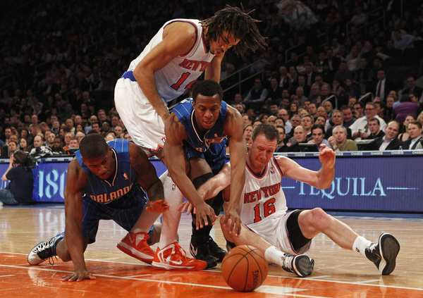 Orlando Magic forward DeQuan Jones (L), point guard Ish Smith (2nd R), New York Knicks forward Chris Copeland (2nd L) and forward Steve Novak (R) fight for a loose ball in the second quarter of their NBA basketball game at Madison Square Garden in New York, January 30, 2013.