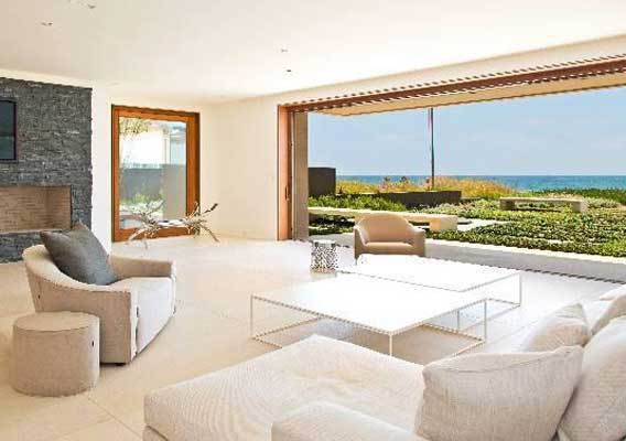 Businessman Fred Sands has purchased a beach house in Malibu for $14.7 million.