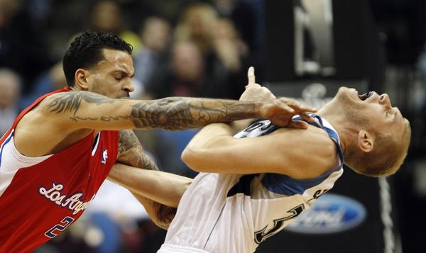 L.A. Clippers' forward Matt Barnes (L) pushes Minnesota Timberwolves' center Greg Stiemsma during the first half of their NBA basketball game in the Target Center in Minneapolis, January 30, 2013. Barnes was ejected from the game after the altercation.