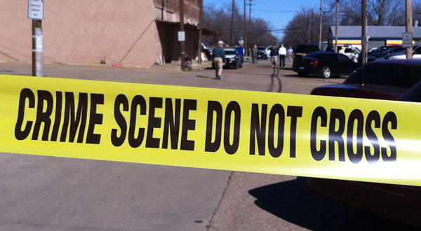 Law enforcement officers investigate the scene of a shooting in downtown Kaufman, Texas.