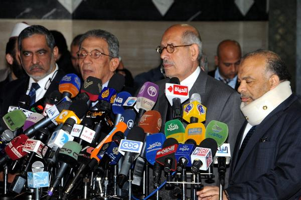 Nobel Peace Prize laureate Mohammed ElBaradei, third from the left, and Freedom and Justice Party leader Saad Katatni, right, join other political figures during a news conference Thursday in Cairo calling for a dialog to end violent protests.