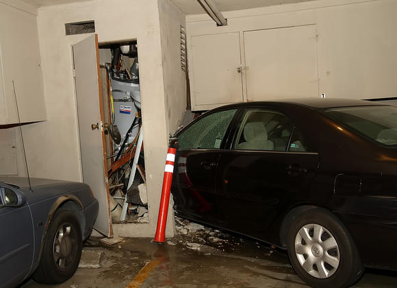 The damaged car that drove into the building at 458 E Tujunga Avenue.