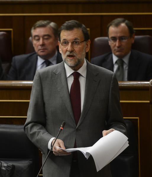 Spanish Prime Minister Mariano Rajoy gives a speech during a Parliament session in Madrid on Wednesday. The newspaper El Pais printed a report Thursday purporting to link Rajoy and other members of his conservative party to under-the-table cash payments.