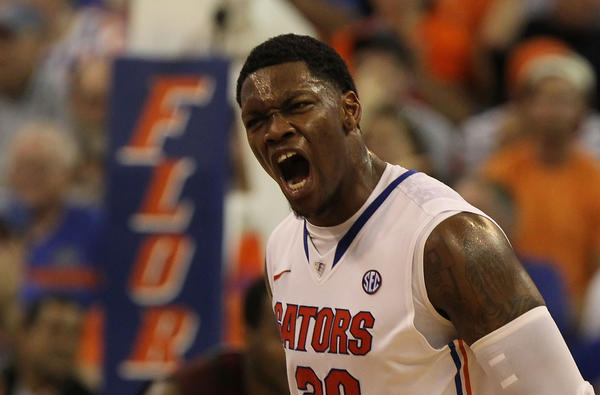 Florida Gators guard Michael Frazier II (20) reacts after making a three pointer against the South Carolina Gamecocks during the second half at the Stephen C. O'Connell Center. Florida Gators defeated the South Carolina Gamecocks 75-36.