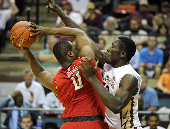 Maryland Terrapins forward Charles Mitchell (0) tries to pass the ball as he is defended by Florida State Seminoles center Michael Ojo (50) during the first half of the game at the Donald L. Tucker Center.