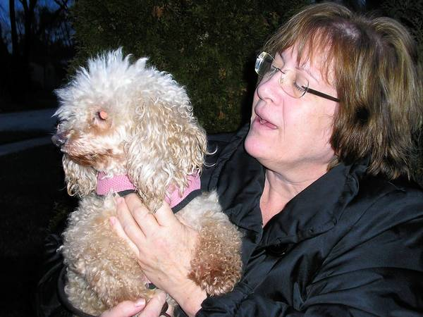 Diane Hewitt and her dog, Cindy. Hewitt's dog was attacked by another dog and seriously injured.