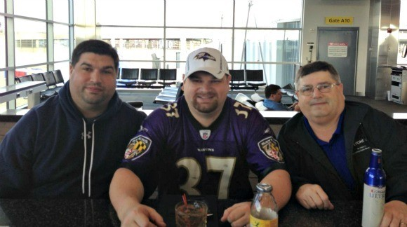at airport bar ravens gear on