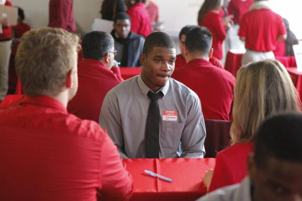 Business management student Matthew Brathwaite, 22, originally from Jamaica, applies for an overnight logistics position at a Target job fair in Los Angeles.