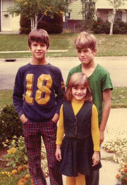 (From left) John, Jim and Joanie Harbaugh.