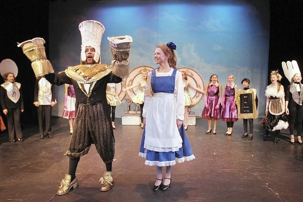 "Elliet Glade, who plays Belle, center, and Marty Williams, as Lumiere, left, rehearse a scene from Thurston Middle School's performance of Disney's ""Beauty And The Beast"" on Wednesday."