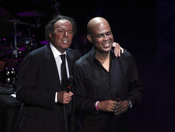 Julio Iglesias, left, is joined onstage by former singer and current president of Haiti Michel Martelly during a charity concert in the Dominican Republic last December.