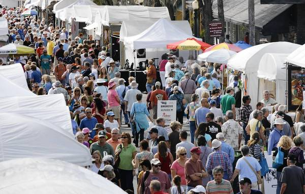 A crowd lines Donnelly Street during the 37th annual Mount Dora Arts Festival on Saturday, February 4, 2012. (Stephen M. Dowell/Orlando Sentinel)