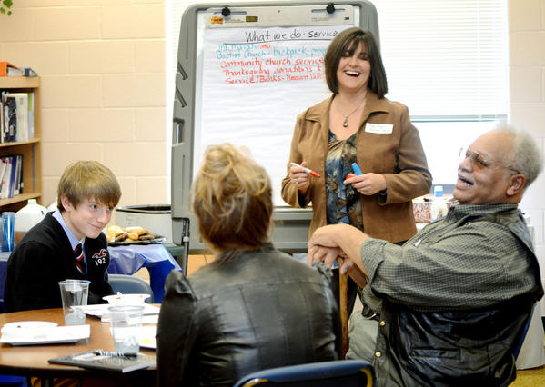 James Fisher, right, of Mount Moriah Baptist Church in Knoxville, Boonsboro High School Principal Peggy Pugh, center, and student Matt Scalese, left, laugh during a conversation about community service Thursday at Boonsboro High School. The luncheon gave student and community leaders a chance to discuss service opportunities.