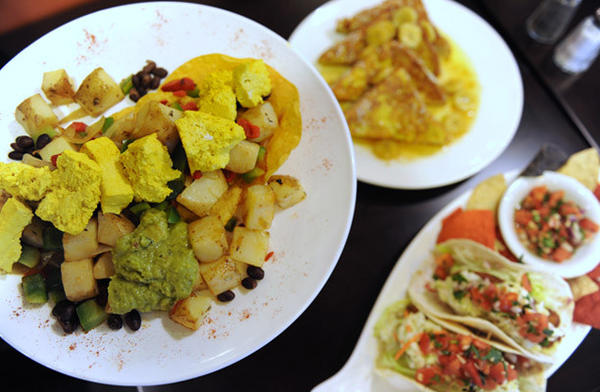 The vegan dish 'No Huevos Rancheros,' Fish Tacos and Bananas Foster French Toast are served in Griddle 145, in Whitehall.