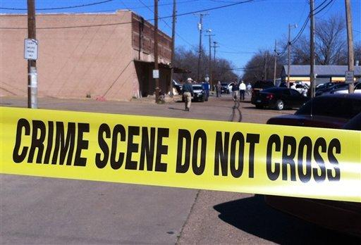Authorities at the scene where a prosecutor was shot to death in downtown Kaufman, Texas.