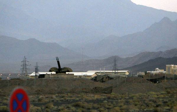 A 2007 photo shows an antiaircraft gun at Iran's uranium enrichment complex at Natanz. Iran plans to boost the production capability at the site with faster centrifuges.