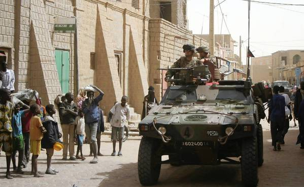 French troops make their way down a street in Timbuktu, Mali.