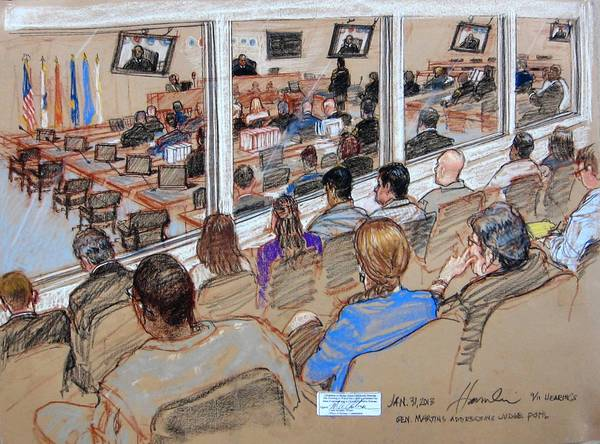 Observers watch the Sept. 11 hearings from a viewing gallery at the U.S. Naval Base at Guantanamo Bay, Cuba. The proceedings are broadcast to a courtroom in Ft. Meade, Md., with a 40-second delay for government censors.
