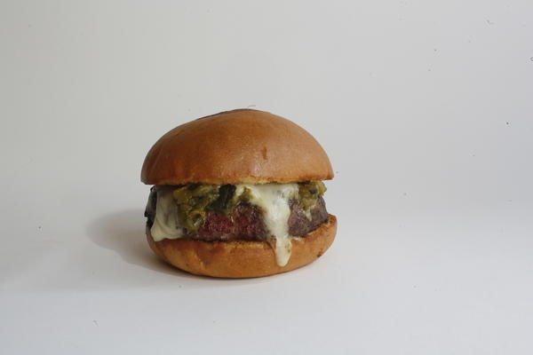 The Hatch burger at Umami features four types of green chilis and house cheese.