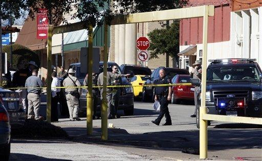 Authorities investigate a prosecutor's shooting death in Kaufman, Texas.