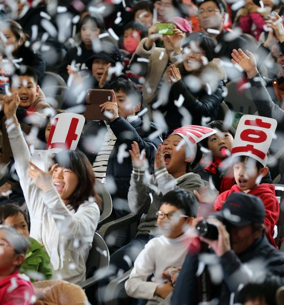 South Korean schoolchildren in Gwacheon celebrate as they watch TV news reporting on the country's first successful satellite launch. North Korea launched a long-range rocket to put a satellite into orbit in mid-December. A new space race is being fueled in Asia as rival states seek to project an image of power and technological prowess.